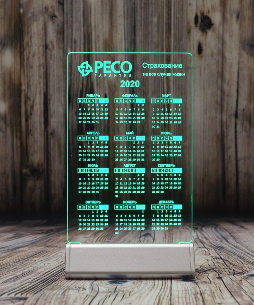 Акрилайт Питер заказать оптом недорого настольный бизнес-сувенир с подсветкой светящийся логотип компании корпоративный подарок календарь пеко